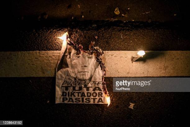 An image of former dictator Ferdinand Marcos and Philippine President Rodrigo Duterte is burned during the 48th anniversary of the Martial Law...