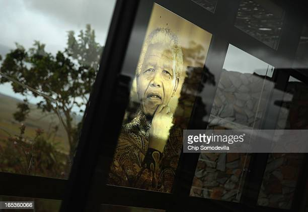 An image of former South African President Nelson Mandela is pasted into a window at the Nelson Mandela Museum's Youth and Heritage Center April 2...
