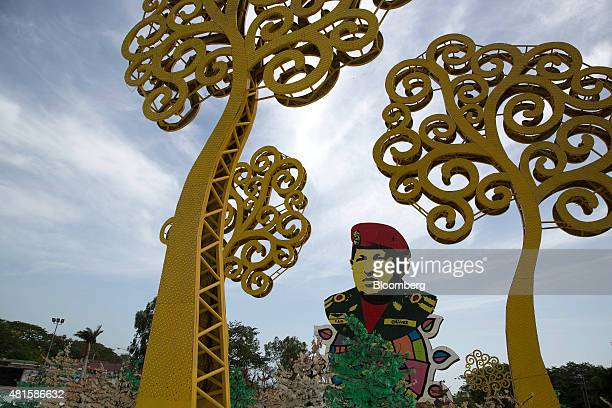 An image of former Venezuelan President Hugo Chavez stands next to 'Trees of Life' in Managua Nicaragua on Wednesday July 8 2015 The Central Bank of...