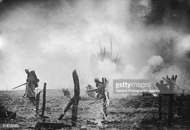 An image of French troops advancing under fire during World War I France circa 1916 The scene is likely to have been staged with smoke and explosions...