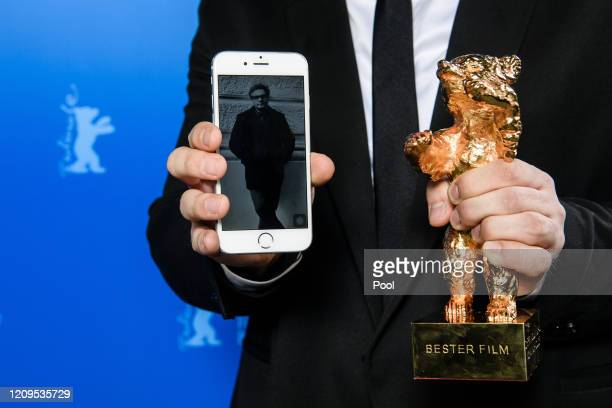 An image of Iranian director Mohammad Rasoulof winner of the Golden Bear for Best Film for the film There Is No Evil is presented next to his award...