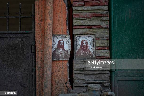 An image of Jesus Christ and Mother Mary on a wall of a house is seen damaged by a fissure caused by Taal Volcano's eruption on January 18 2020 in...
