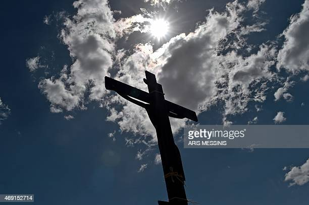 An image of Jesus crucified stands at a hill during the ceremony marking the Apokathelosis the removal of Christ's dead body from the Cross which...