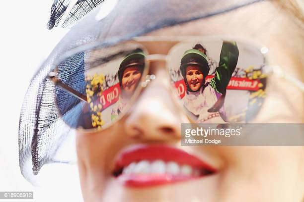 An image of jockey Michelle Payne is reflected on a racegoers glasses on Derby Day at Flemington Racecourse on October 29 2016 in Melbourne Australia