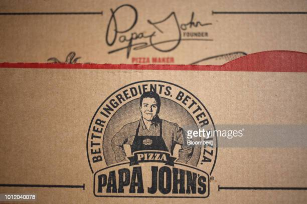 An image of John Schnatter founder of Papa John's International Inc is displayed on a pizza box in Shelbyville Kentucky US on Friday Aug 3 2018 Papa...