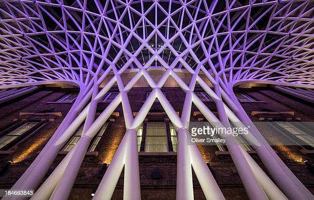 An image of Kings Cross looking straight up towards the roof, the newly-renovated station has some very interesting interior design and it has a very...