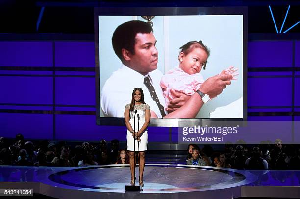 An image of late boxer Muhammad Ali is projected onto a screen as retired boxer Laila Ali speaks onstage during the 2016 BET Awards at the Microsoft...