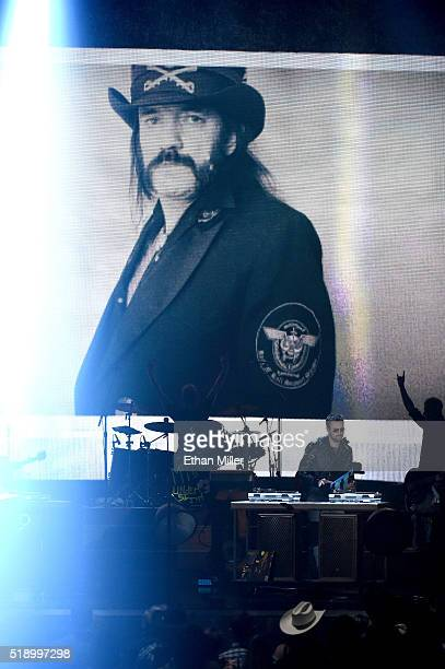 An image of late recording artist Ian 'Lemmy' Kilmister from music group Motorhead appears on a video screen as recording artist Eric Church performs...
