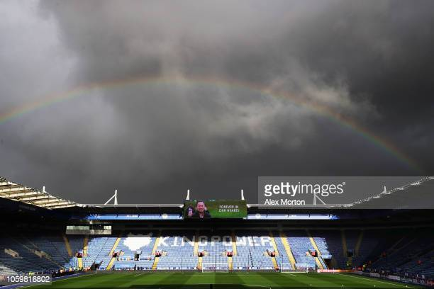 An image of Leicester City chairman Vichai Srivaddhanaprabha is displayed on the screen inside the stadium as a rainbow is seen over the stadium...