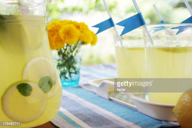 An image of lemonade with blue flags and yellow flowers