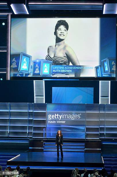 An image of Lifetime Achievement Award honoree the late Ruth Brown is displayed on a video screen as recording artist Bonnie Raitt speaks onstage...