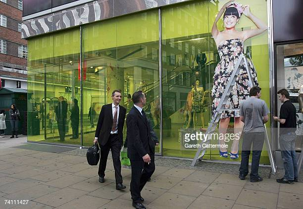 An image of Lily Allen is put up outside the New Look Store before the public launch of the 'Lily Loves' collection at the New Look store on Oxford...