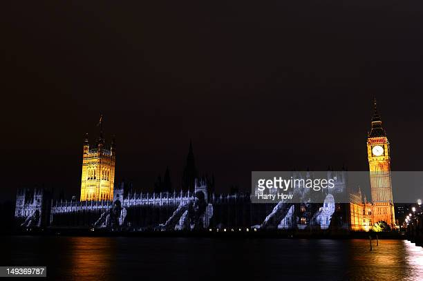 An image of long jumper Bob Beamon is projected onto the House of Parlilament and Big Ben during a light show to mark the start of the 2012 Olympic...
