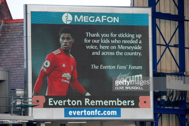An image of Manchester United's English striker Marcus Rashford is pictured alongside a message of thanks to him for his campaign to get Britain's...