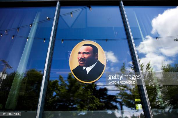 An image of Martin Luther King Jr. Is pictured in the newly created Capitol Hill Autonomous Zone , in Seattle, Washington on June 11, 2020. - The...