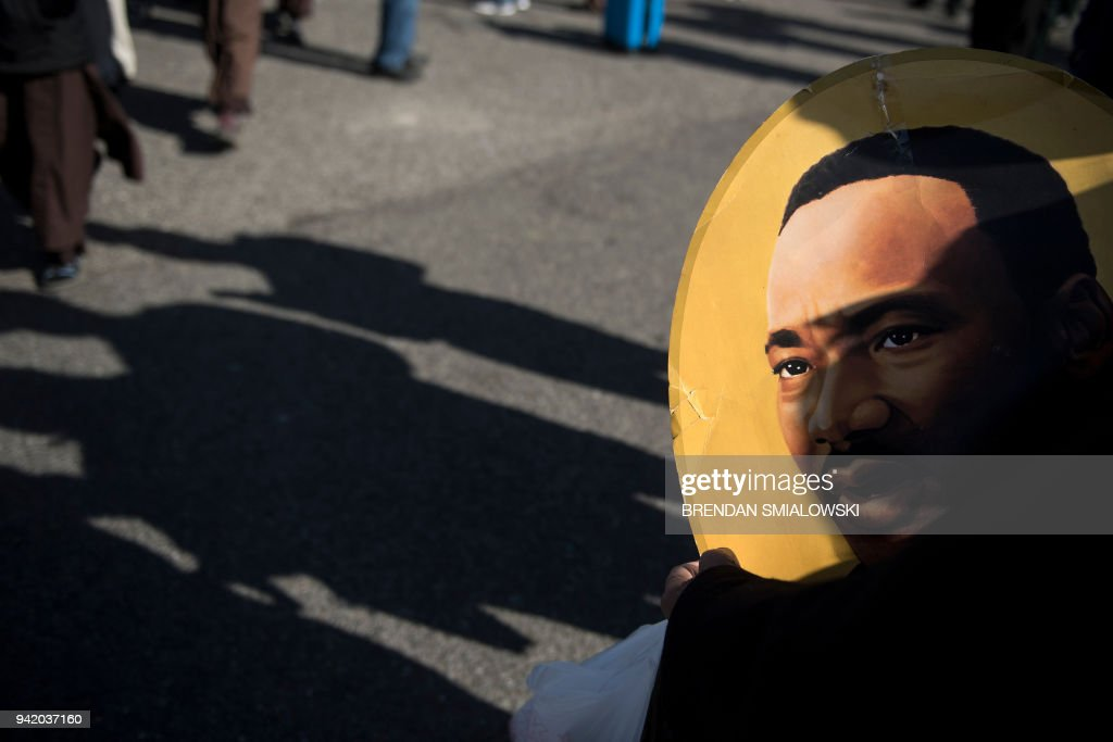 An image of Martin Luther King Jr. is seen during an event at the Lorraine Motel commemorating the 50th anniversary of the assassination of Martin Luther King Jr. April 4, 2018 in Memphis, Tennessee. / AFP PHOTO / Brendan Smialowski