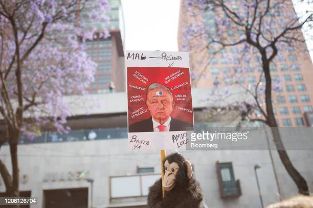 An image of Mexican President Andres Manuel Lopez Obrador is displayed on a sign during a rally on International Women's Day in Mexico City Mexico on...
