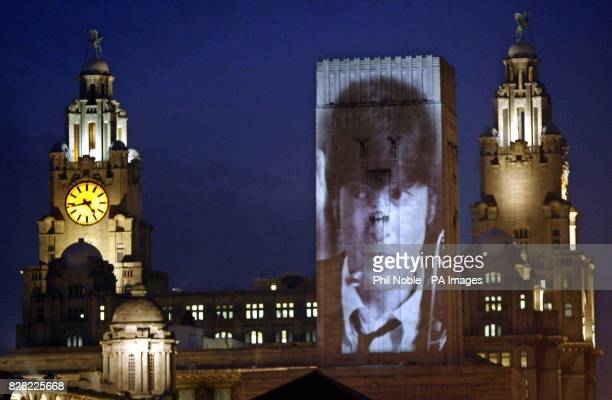 An image of murdered music icon John Lennon is projected Thursday December 8 onto a Liverpool waterfront building during a day of events to mark the...