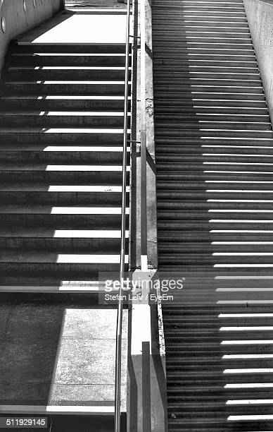 an image of parallel sets of stairs - parallel stock photos and pictures