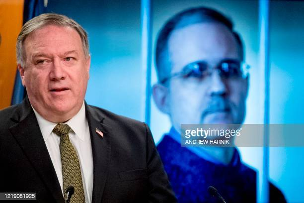 An image of Paul Whelan a former US marine who was arrested for alleged spying in Moscow is displayed behind Secretary of State Mike Pompeo as he...