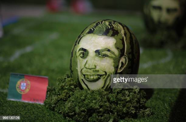 An image of Portugal's forward Cristiano Ronaldo is carved on a watermelon in Shenyang in China's northeastern Liaoning province on July 10 2018 /...