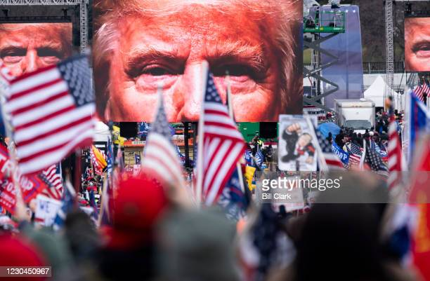 An image of President Donald Trump appears on video screens before his speech to supporters from the Ellipse at the White House in Washington on...