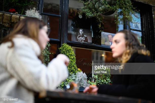 An image of Prince Philip is seen in a pub window, as tributes continue to be made to Prince Philip, the Duke Of Edinburgh who died at age 99 on...