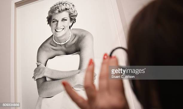 An image of Princess Diana is inspected at the press preview for 'Vogue 100 A Century of Style' exhibiting the photographs that has been commissioned...
