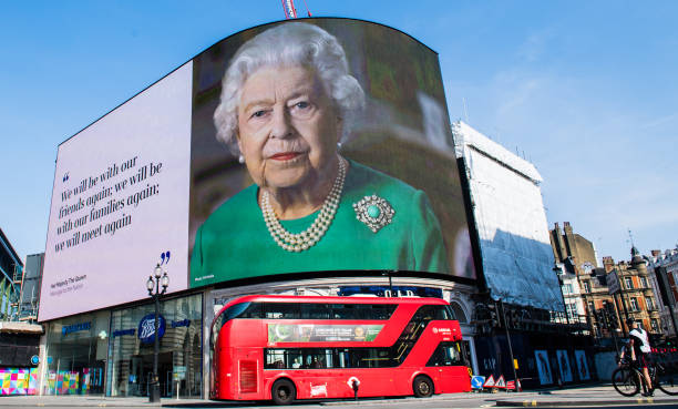 GBR: Quotes From Queen's Coronavirus Broadcast Displayed in Piccadilly Circus