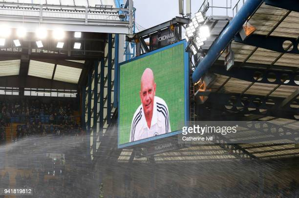 An image of Ray Wilkins is shown on the screen before the Premier League match between Chelsea and Tottenham Hotspur at Stamford Bridge on April 1...