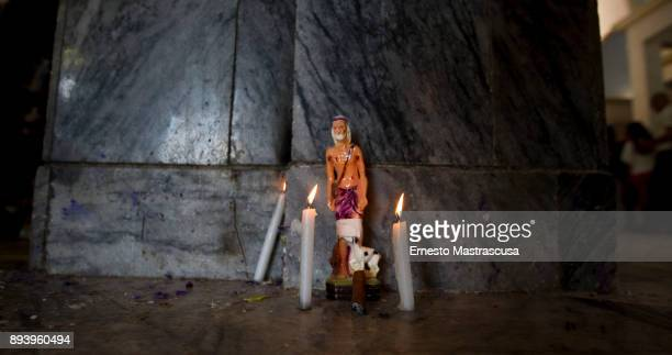 An image of San Lazaro is illuminated with candles on December 16 2017 in La Habana Cuba Thousands of believers gather at the Shrine of San Lazaro on...