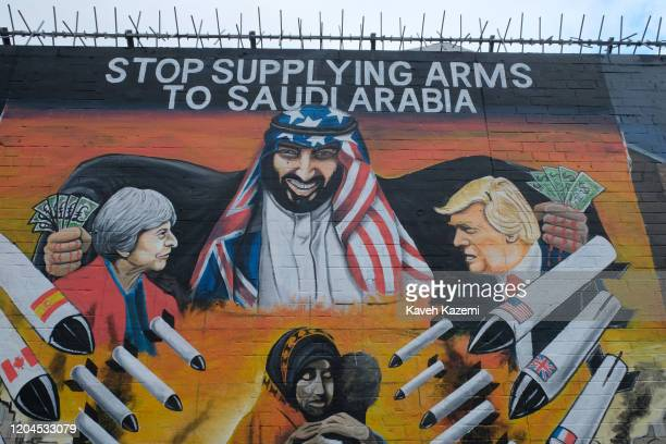 An image of Saudi Arabiau2019s Prince Ben Salman depicting him with bloody hands full of US Dollar notes buying arms and missiles from Donald Trump...