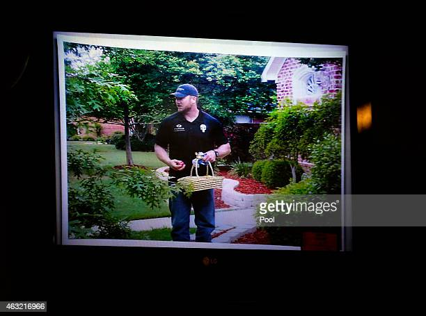 An image of slain Navy SEAL Chris Kyle on Easter day hiding Easter eggs is shown on a monitor during the capital murder trial of former Marine Cpl...