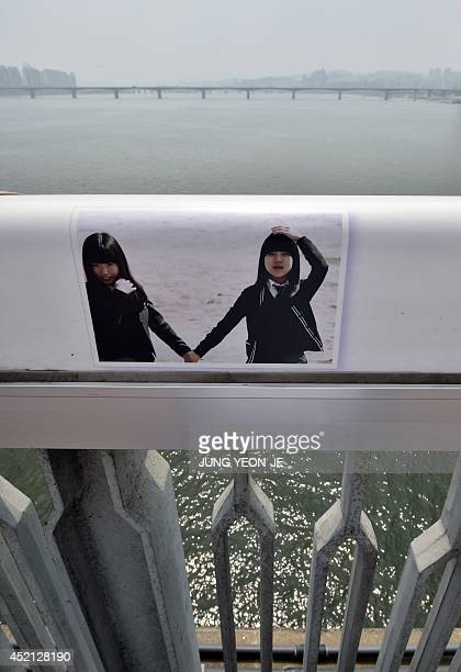 An image of students is displayed along the railing to dissuade potential suicides on Mapo Bridge a common site for suicides over the Han river in...