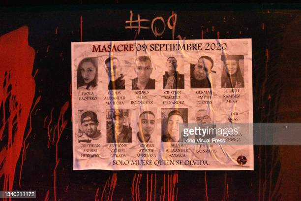 An image of the 13 people who died during protests that reads 'Massacre of September 9, 2020' as police guards the Villa Luz CAI police station were...
