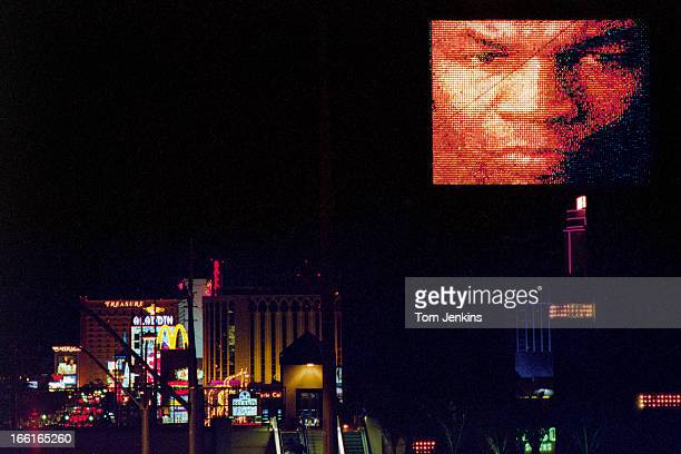 An image of the American boxer Mike Tyson appears on a big screen above the hotels and casinos of Las Vegas the day before his world heavyweight...