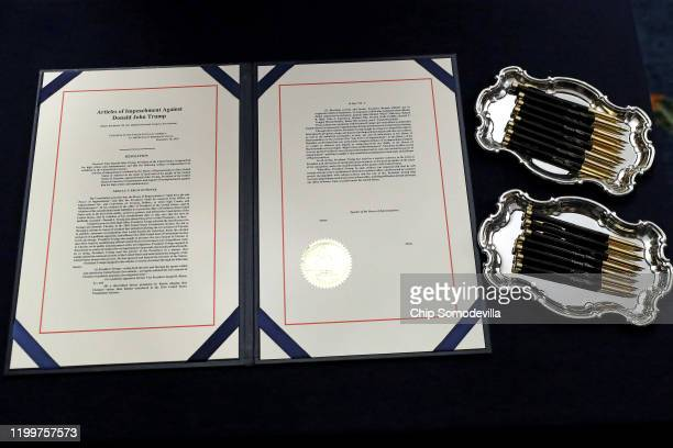An image of the articles of impeachment against President Donald Trump and the ceremonial pens that will be used by Speaker of the House Nancy Pelosi...