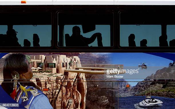 –An image of the completed Skywalk adorns the sides of a tour bus at Grand Canyon WestThe Hualapai Tribe in Peach Springs Arizona is building a...