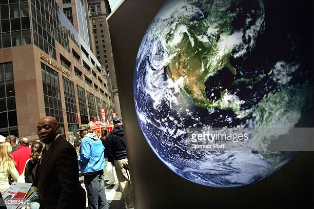 An image of the earth is displayed outside of a booth celebrating the 35th anniversary of Earth Day April 22 2005 in New York City While...