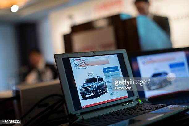 An image of the Great Wall Motor Co Haval H8 sport utility vehicle is displayed on a laptop screen during the company's annual results news...