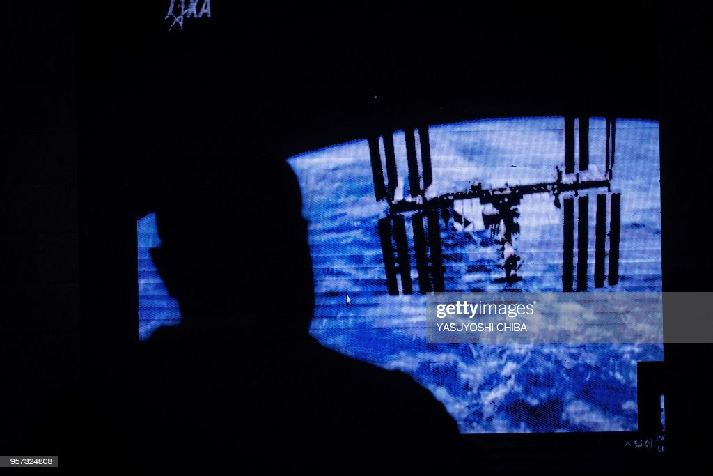 An image of the International Space Station (ISS) is projected during the public viewing of deployment of Kenyas first nano satellite (CubeSat) from the ISS at the University of Nairobi in Nairobi on May 11, 2018. - Kenya's first satellite, ten cubic centimeters, is developed and operated by University of Nairobi under the KiboCUBE programme between United Nations Office for Our Space Affairs (UNOOSA) and Japan Aerospace Exploration Agency (JAXA) to offer developing countries the capacity-building initiative to develop space technologies.