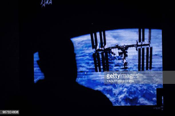 An image of the International Space Station is projected during the public viewing of deployment of Kenyas first nano satellite from the ISS at the...