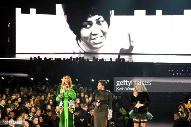 An image of the late Aretha Franklin is projected on a screen while Yolanda Adams Fantasia and Andra Day perform onstage during the 61st Annual...