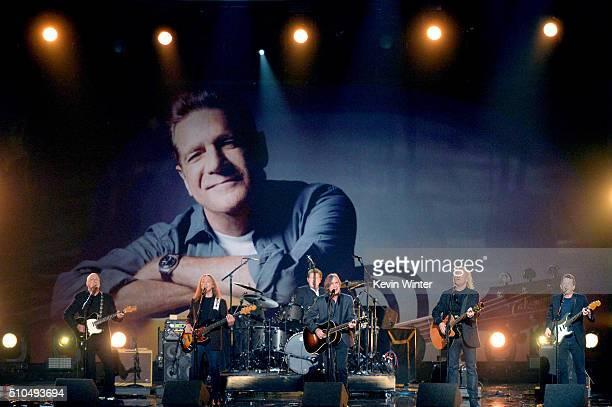 An image of the late Glenn Frey is displayed on a video screen as recording artists Bernie Leadon Timothy B Schmit Don Henley Jackson Browne Joe...