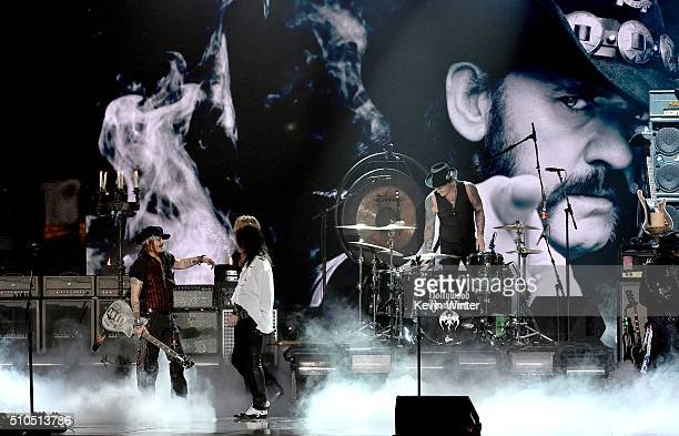 An image of the late Ian 'Lemmy' Kilmister of music group Motorhead is projected on a video screen as musicians Johnny Depp Alice Cooper and Matt...