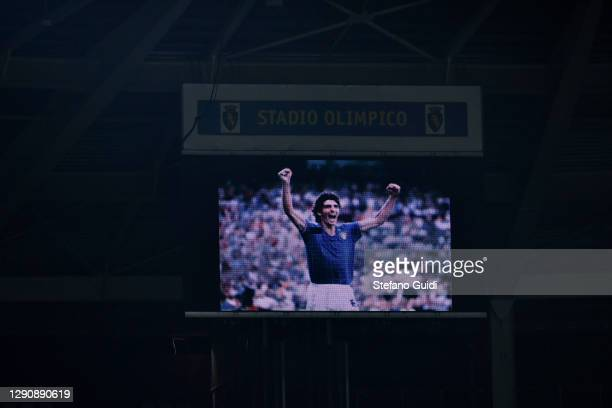 An image of the late Italy World Cup hero Paolo Rossi is projected in the stadium's screen as players and officials observe a minute's silence as a...
