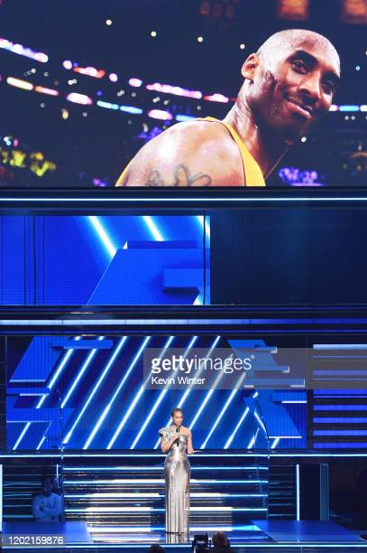 An image of the late Kobe Bryant is projected onto a screen while host Alicia Keys speaks onstage during the 62nd Annual GRAMMY Awards at STAPLES...