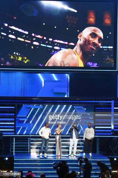 An image of the late Kobe Bryant is projected onto a screen while Host Alicia Keys and Nathan Morris Wanya Morris and Shawn Stockman of music group...