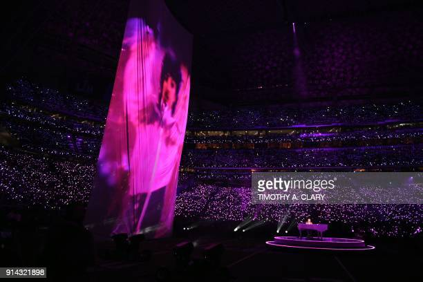 TOPSHOT An image of the late US musician Prince is projected on a large screen as Justin Timberlake performs on stage during the Super Bowl LII...