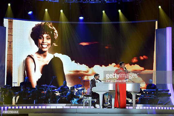 An image of the late Whitney Houston appears on a video screen as honoree Kenneth Babyface Edmonds and recording artist Fantasia Barrino perform...